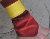 Toph's Red Wrist Cuffs