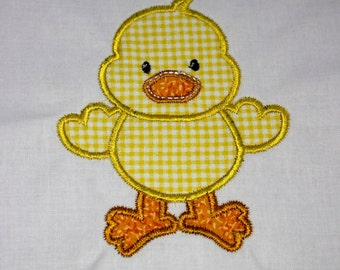 Baby Duck bodysuit or infant nightgown.