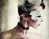 "Title: ""Masquerade""  Photographic portrait of a woman in a white mask. - SpokeninRed"