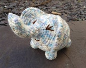 Oscar the elephant, colourful amigurumi crochet toy.