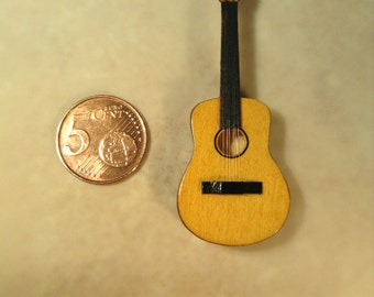 Miniature guitar made of basswood.