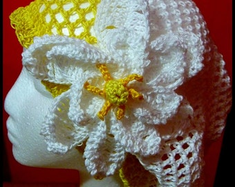 white and yellow slouch hat with gardenia flower