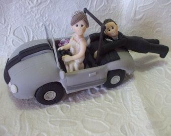 funny wedding cake topper with car