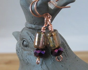 Glass bead earrings: Purple facets, antiqued smokey glass, and copper wire