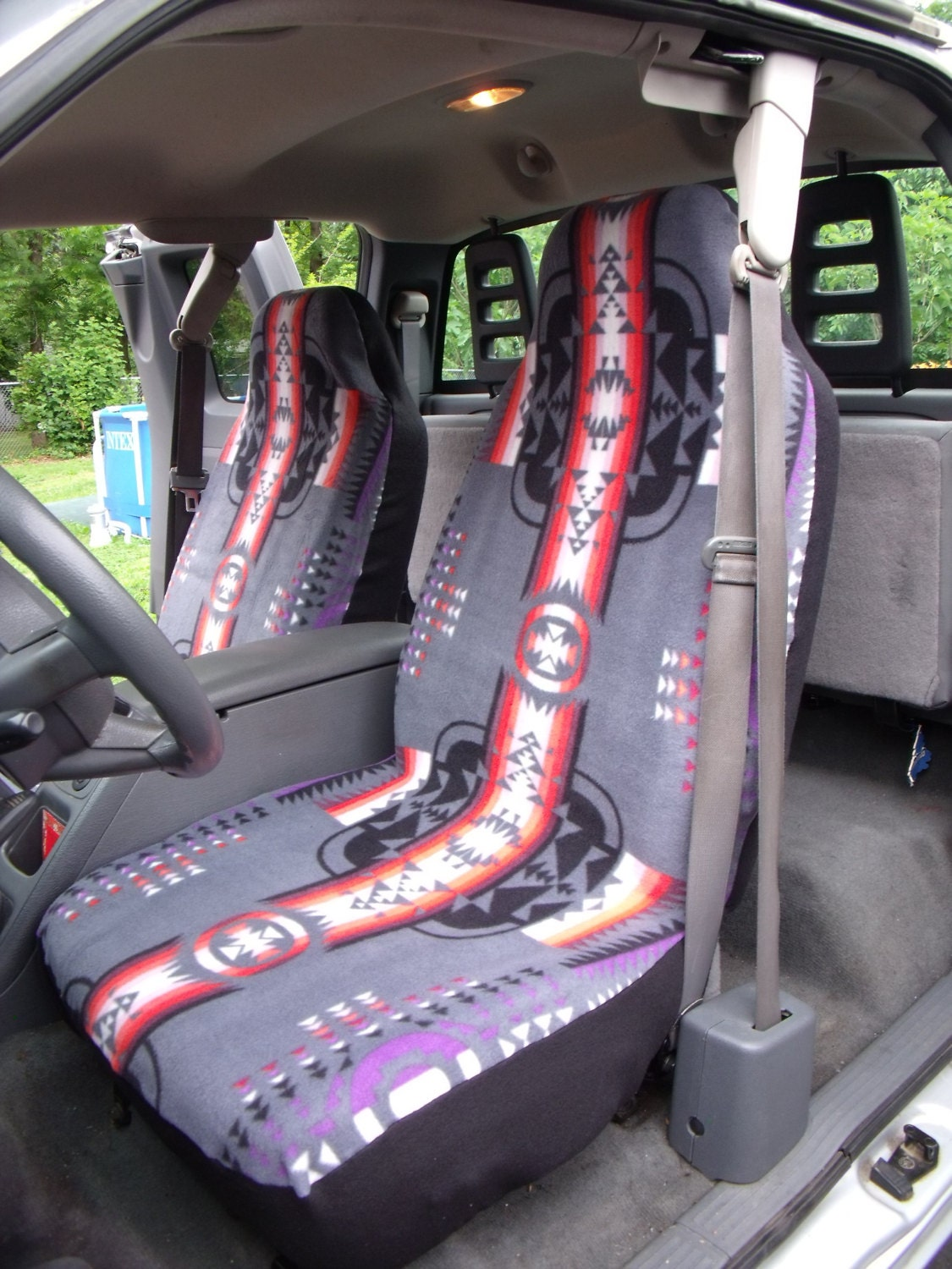 1 set of tribal print car seat covers and the steering wheel. Black Bedroom Furniture Sets. Home Design Ideas
