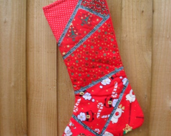 Red Christmas Stocking with seven different Christmas fabrics on the front.  Felt backed. Patchwork Christmas stocking. Item No. LDC0233