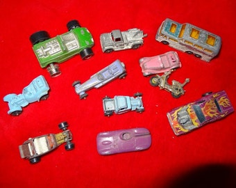 Lot of old toy cars, wrecker truck, passenger bus, and race cars.   10 vehicles and 1 motorcyle