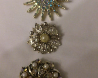 Three vintage rhinestone brooches