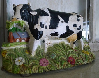 Cast iron cow doorstop or bookend