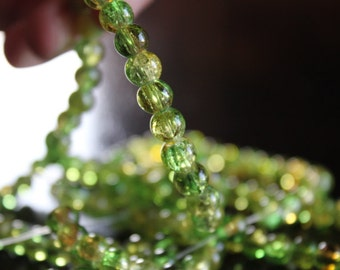 135 approx. green and yellow 6 mm crackle glass beads, 1mm hole, round and smooth