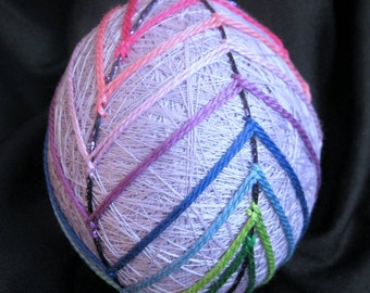 Embroidered lavender egg-shaped temari ball