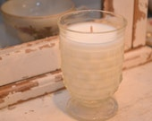 Candle in vintage small clear glass cup
