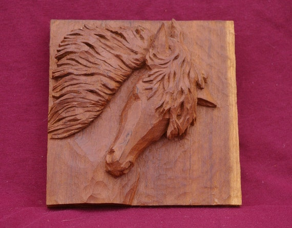 Items similar to relief carving of horse head for hanging