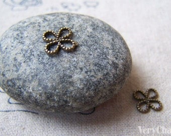 50 pcs of Antique Bronze Tiny Coiled Chinese Knot Flower Charms 8mm A5652
