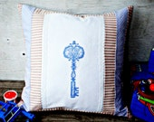 Pillow cower in pink blue colors. Embroidery cross: key. Excellent gift to the newborn