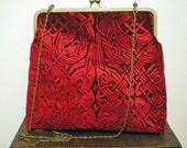 A beautiful kisslock handbag in an embossed iridescent velvet celtic design