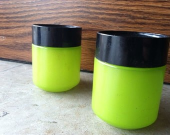 Lime green salt pepper shakers with black lids