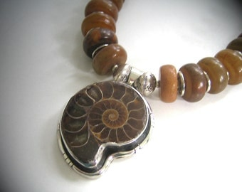 Amun:  Honey jadeite, sterling silver pendant with fossilized ammonite. Necklace and earring set.