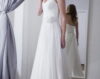 Chiffon style strapless gown light flowy wedding dress perfect for beach garden destination wedding