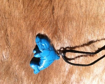 Carved stone dolphin necklace.  Made of turquoise.