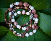 Set of four beaded bracelets. Handmade beaded bracelets. African style beaded bracelets. Bracelets made from gemstones and natural wood.