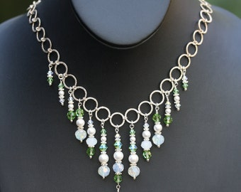 Necklace and earrings of Swarovski pearls and crystals. Elegant runway style or bridal set.
