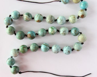 Jewelry: Turquoise and knotted leather Necklace