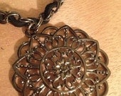 Pretty Chain intertwined with suede cord and beautiful flower charm