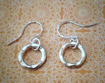 Sterling Silver round hammered circles.