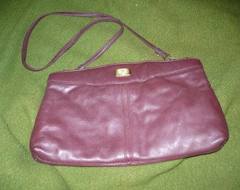 Etienne Aigner purse, maroon, leather, can be a clutch.