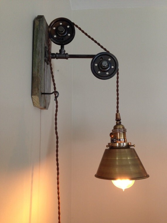 Small wall hanging industrial pendant light with pulleys and