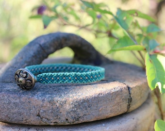 Turquoise, blue and gold string bracelet with gold button clasp