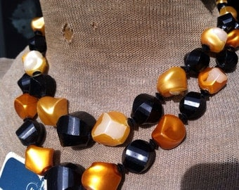 Black and Orange Beaded Necklace with matching earrings.