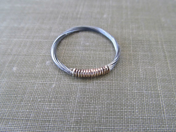gold and silver guitar string ring wire by thechestnutforge