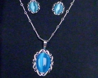 ladies necklace and matching earrings, blue fiber optic cat's eye in sterlling silver