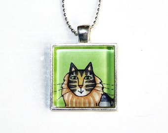 SALE... Maine Coon Brown Tabby Cat Glass Pendant in Silvertone Setting, Green Background
