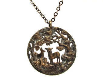 woodland scene pendant with deer, fire polished cast bronze