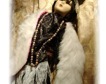 A Boudoir Doll In Black, Silver And Fur