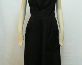 vintage 1950s black sleeveless dress with bows / 1950s party dress / rockabilly pinup dress / hollywood vixendress / bombshell 1950s