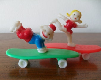 Vintage Clown and Little Girl on Skateboard Cake Topper 70s Hard Plastic Party Decoration