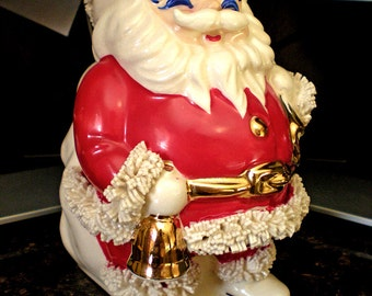 """Santa Claus Money Bank Spaghetti Trim, Red and White Christmas Decoration, Jolly St. Nick Twinkling Eyes, 6-1/2"""" High by 5"""" Wide"""