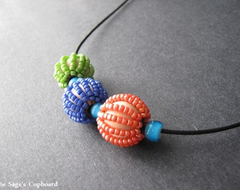 Autumn Bauble Necklace. Beaded Blue Green and Orange Adjustable Necklace