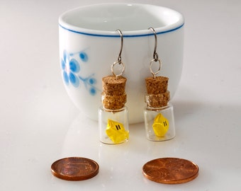 Origami earring Mario Bros star in tiny glass bottle