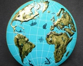 Going around the world in circle. Vintage globe map metal box.