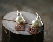 paw print dangle earring with pearl beads