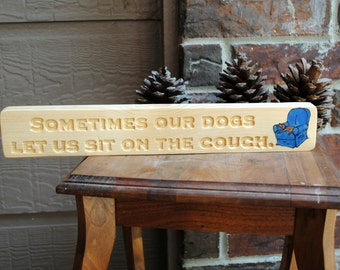 Sometimes our dogs let us sit on the couch. - Reclaimed Wood Sign, Carved, Hand Painted