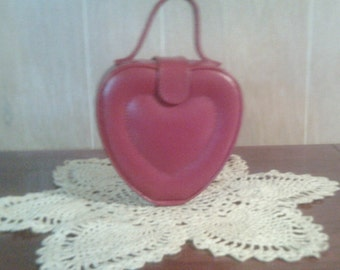 small red leather heart bag