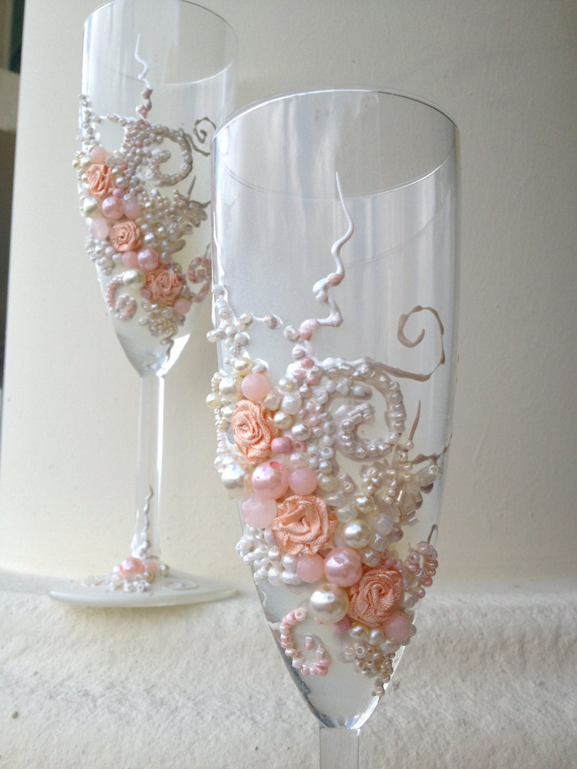 beautiful wedding champagne glasses in blush pink and ivory