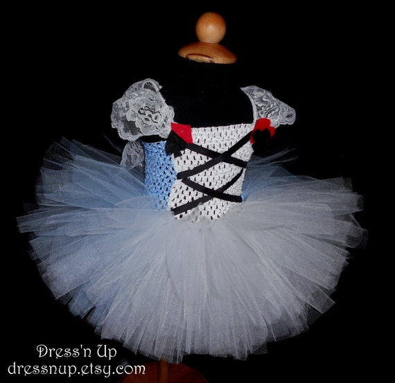 Items similar to Alice in Wonderland dress baby girl