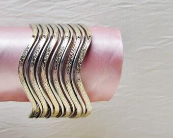 Set of 11 zig zag bangles, 1950's bracelet set